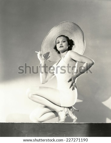 woman posing in a wide brim hat