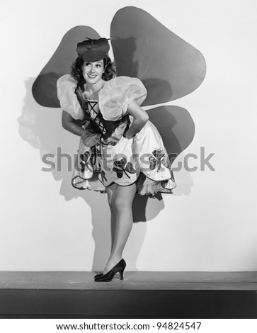 Woman posing in front of large shamrock
