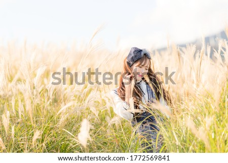 Woman posing in front of pampas Сток-фото ©