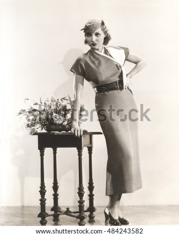 Woman posing in long dress with matching hat