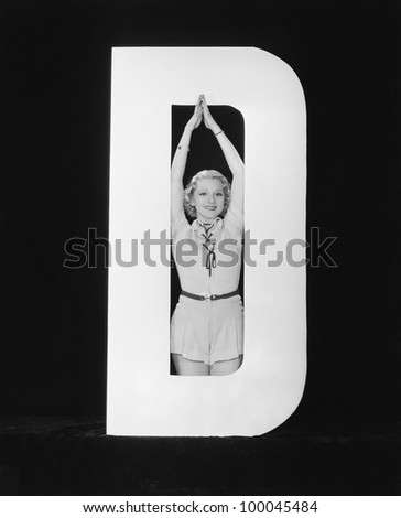 Woman posing in middle of letter D