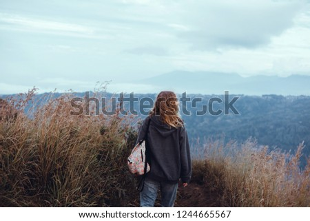 Woman posing in the volcano with backpack.street photo portrait, l girl,using backpack, travel vibes, hipster girl, outdoor close up portrait, happy face, Bali, hipster mood, crazy female Stock fotó ©