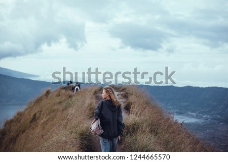 Woman posing in the volcano with backpack.street photo portrait, l girl,using backpack, travel vibes, hipster girl, outdoor close up portrait, happy face, Bali, hipster mood, crazy atmospher Stock fotó ©