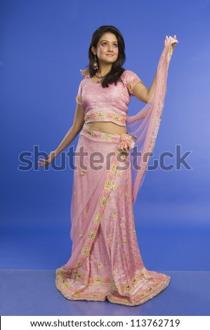 Woman posing in traditional dress