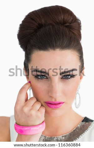 Woman posing with beehive and pink lips on white background
