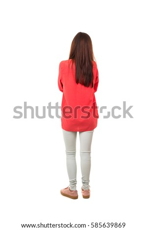 Woman posing with her back faced to camera, isolated over copy space background