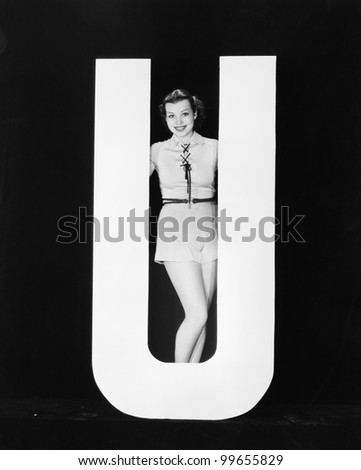 Woman posing with huge letter U