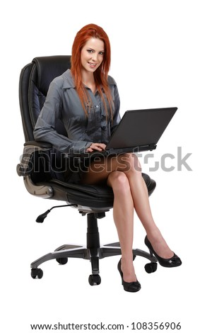 woman posing with laptop on chair, isolated on white