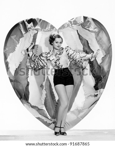 Woman posing with large heart