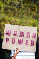 Woman power. Hand of a protester holding a banner calling for gender equality on March 8, International Women's Day. Feminism, demonstrations, protest, women's rights.