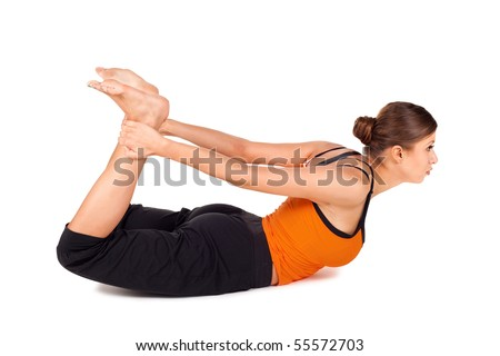 woman practicing yoga exercise called bow pose sanskrit