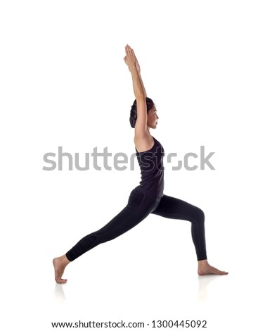 Woman practicing yoga standing in variation of Warrior I posture or Virabhadrasana One pose isolated on white, with clipping path