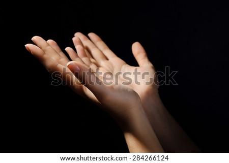Woman praying in darkness #284266124