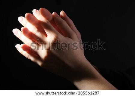 Woman praying in darkness #285561287