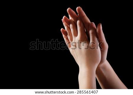 Woman praying in darkness #285561407