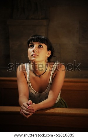 Woman praying in the church