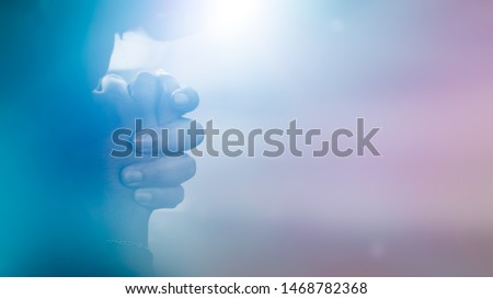 Woman praying on the bed at home.Teenager woman hand praying,Hands folded in prayer on the bed in the morning.Concept for faith, spirituality and religion.Social distancing stay home for lockdown.