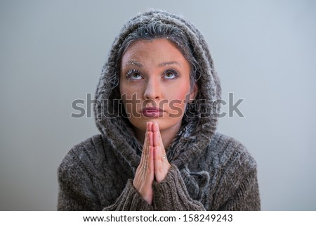 Woman praying. Wearing hoodie. Frost on her face #158249243