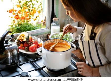Woman preparing a pumpkin soup