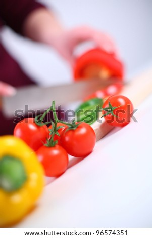 Woman preparing a salad, shallow DOF