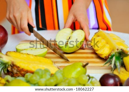 woman preparing fruit salad