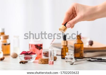 Woman preparing perfume on table Foto stock ©