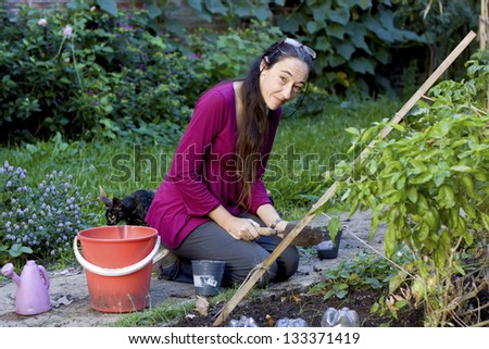 Woman preparing the ground by the arrival of spring
