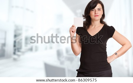 Woman presenting a blank sign in a corporate background