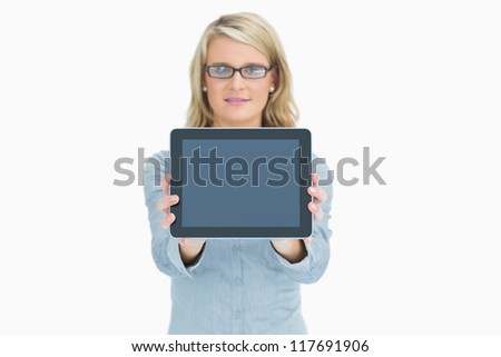 Woman presenting her tablet and smiling