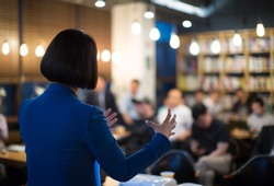 Woman Presenting to Audience. Business Presentation Conference Meeting