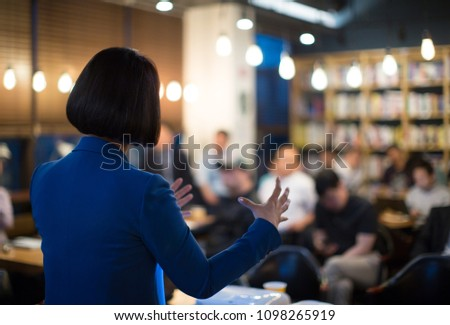 Woman Presenting to Audience. Business Presentation Conference Meeting  #1098265919