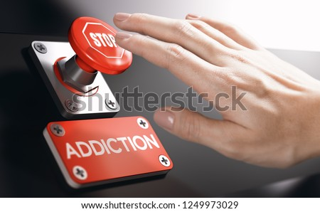Woman pressing a panic button with stop sign to overcome addiction or dependence problems. Psychology concept. #1249973029