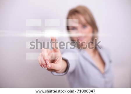 Woman pressing modern light button with one hand