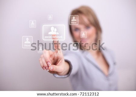 Woman pressing social network button with one hand