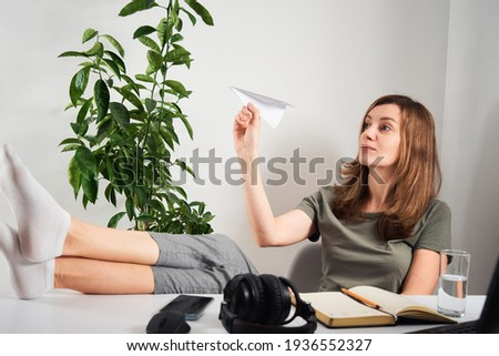 Woman procrastinate at home workplace. Remote work and home office problem Сток-фото ©