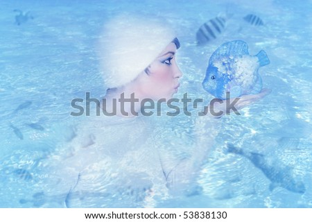 woman profile holding fish kissing expression blue water metaphor [Photo Illustration] #53838130