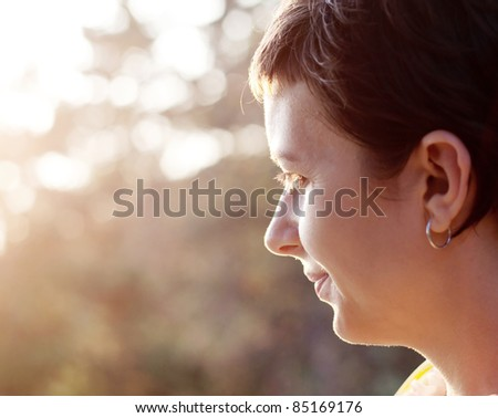 Woman profile in sunset