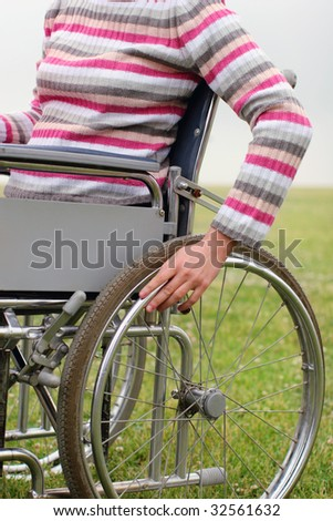 Woman propelling wheelchair