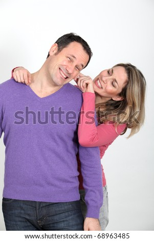 Woman pulling on her boyfriend's cheek