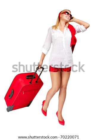 Woman  pulling vacation suitcase talking on phone. Isolated on white