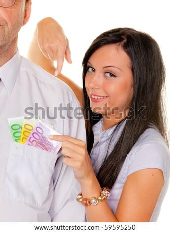 Woman pulls a man ? bills from his pocket