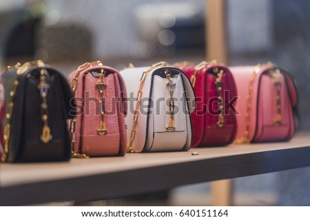 Woman purses in a store in Paris.