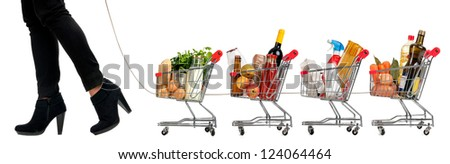 Woman pushing a convoy of small shopping carts full with groceries