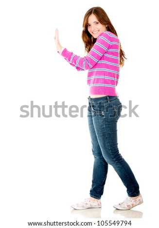 Woman pushing an imaginary object - isolated over a white background