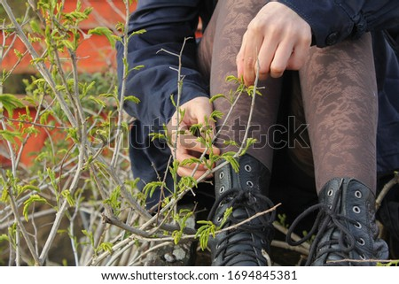 Woman puts her feets in the grass