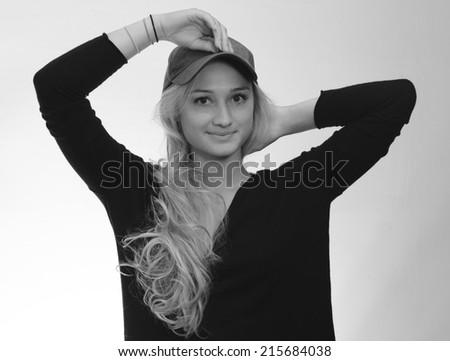 Woman puts on ball cap