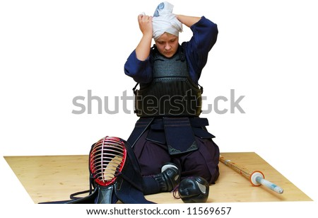 woman puts on kendo uniform. isolated on white