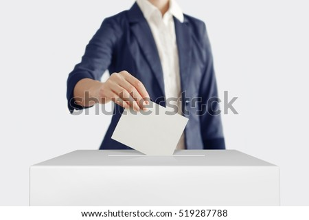 Shutterstock Woman putting a ballot into a voting box.