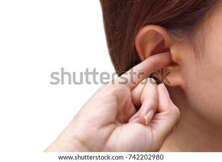 Woman putting a finger into her ear / Itchy ear isolated with copy space                                #742202980