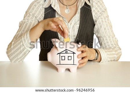 Woman putting coin  in piggy bank. Selective focus.
